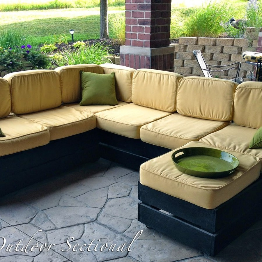 Black Pallet Furniture With Yellow Pillows