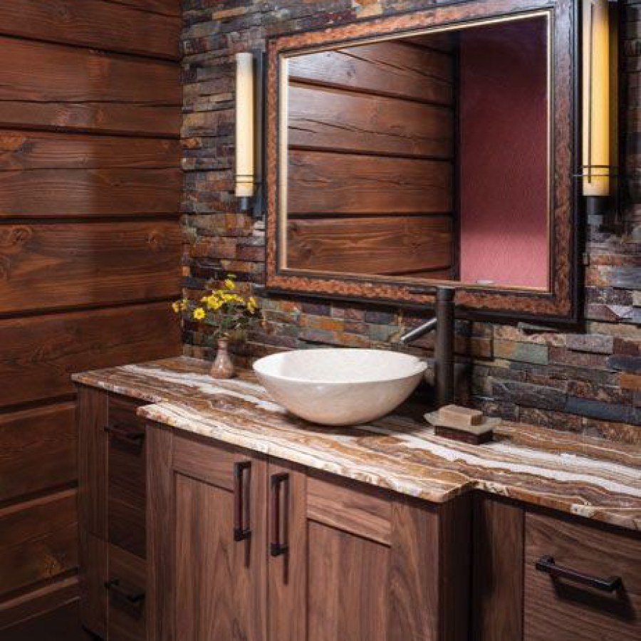 Rustic Bathroom With Wooden Table And Framed Mirror